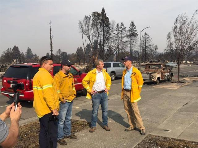Todd Lando of XMR Fire discusses wildfire policy with Congressman Jared Huffman and Businessman Tom Steyer October 16, 2017 at Coffey Park, Santa Rosa.